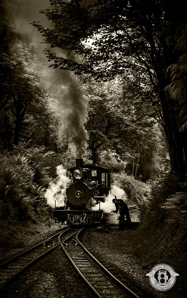 Brecon Beacon Railway train with points man and lots of steam