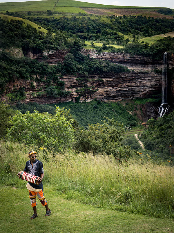 Shongweni farmers market South Africa waterfall with local musician playing accordion