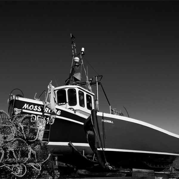 use filters to make the sky dark in a photo of boats in Kent
