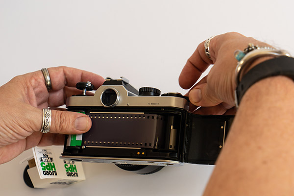 How to load film into a camera - wind the film on a little to ensure film has 'caught'