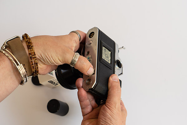 How To Unload 35mm Film - push the small button in
