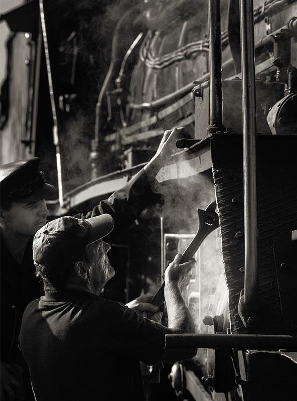 engineer fixing train