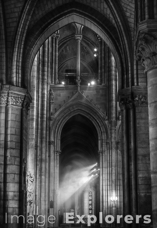 Notre Dame arches and incense smoke