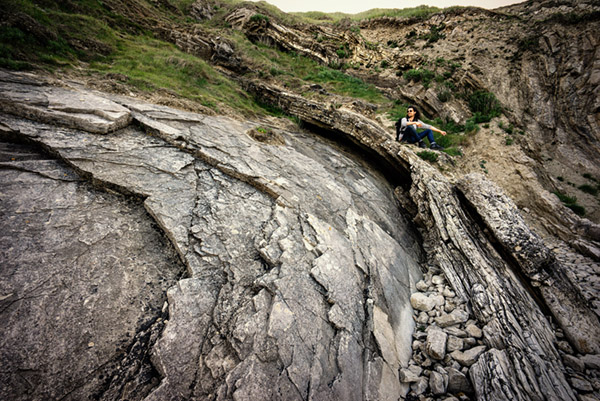 Jethro photographing at Lulworth Cove in the Jurassic rocks.