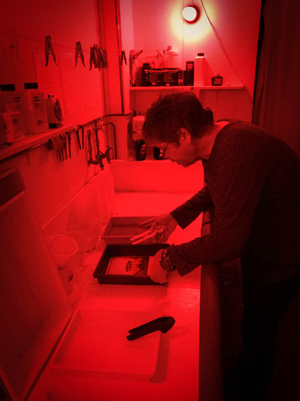 Developing the print in the darkroom