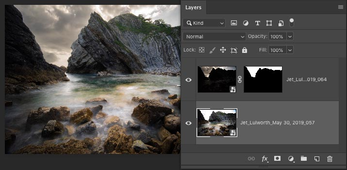 Layer masks hide foreground and show dark sky layer